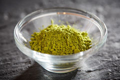Green matcha powder in glass bowl Royalty Free Stock Images