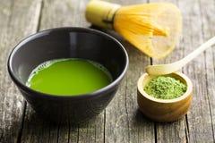 Green matcha tea. Green matcha tea , bamboo whisk, spoon and tea powder stock photo