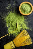 Green matcha tea powder with bamboo whisk , spoon and bowl. Royalty Free Stock Photos