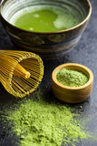 Green matcha tea powder with bamboo whisk , spoon and bowl. Royalty Free Stock Photography