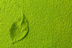 Green matcha tea powder with tea leaf. Green matcha tea powder background with tea leaf, top view from above royalty free stock photos