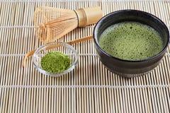 Green matcha tea preparation set on a bamboo table mat Royalty Free Stock Photography