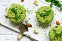 Green matcha vegan raw cakes with mint and nuts. healthy delicious food royalty free stock photography
