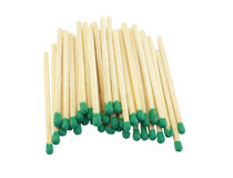 Green matches. Some green matches laying on a white background stock image