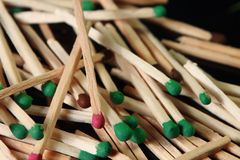 Green matches. It is a lot of green matches on a black background, macro Royalty Free Stock Photo