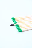 Green matches with burnt match sticking out Stock Photography