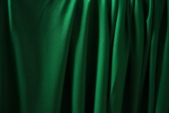 Green material. Abstract painting with light, a green plastic material Stock Photos