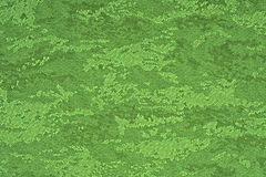 Green material with abstract pattern, a background Royalty Free Stock Photo
