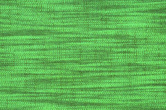 Green material with abstract pattern, a background Royalty Free Stock Image