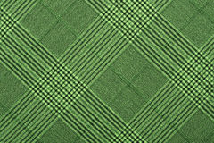 Green material in geometric patterns, a background. Or texture Royalty Free Stock Image
