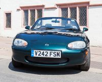 A Green Mazda MX5 in Penrith Town Centre. A green Mazda MX5 car awaits the annual May Day parade in Penrith town centre in Cumbria, England Royalty Free Stock Images