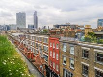 A green meadow with daisies in a warm spring day on the top of Brick Lane in London. 1 royalty free stock photo