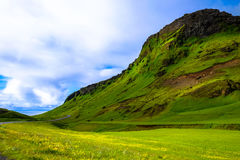 Green meadow and hillside Stock Photos