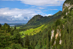 Green meadow among mountains in Bavaria, Germany. Royalty Free Stock Images