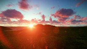 Green meadow and ocean against beautiful timelapse sunset stock footage