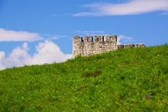 Green meadow with ruins in the background. Ruins of Spis Castle, Slovakia royalty free stock photos