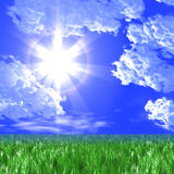 Green meadow and the sun in the dark blue sky Royalty Free Stock Images