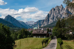 Green Meadow and Typical Houses among Mountains Scenery in Summe. R Time: Cortina D& x27;Ampezzo Stock Image