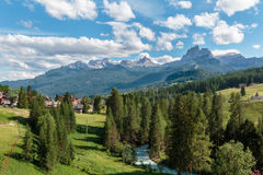 Green Meadow and Typical Houses among Mountains Scenery in Summe. R Time Stock Images