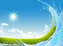 Green meadow and water splash Royalty Free Stock Photo