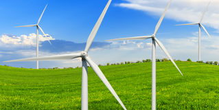 Green meadow with wind power generators stock photography