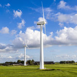 Green meadow with Wind turbines Stock Photos