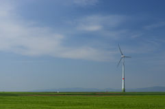 Green meadow with Wind turbines generating electricity. Meadow with Wind power turbines generating electricity royalty free stock photography