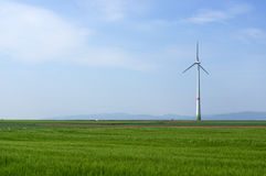 Green meadow with Wind turbines generating electricity. Meadow with Wind power turbines generating electricity royalty free stock image