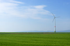 Green meadow with Wind turbines generating electricity. Meadow with Wind power turbines generating electricity stock photography