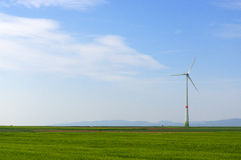 Green meadow with Wind turbines generating electricity. Meadow with Wind power turbines generating electricity royalty free stock images