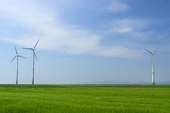 Green meadow with Wind turbines generating electricity. Meadow with Wind power turbines generating electricity stock images