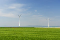 Green meadow with Wind turbines generating electricity. Meadow with Wind power turbines generating electricity stock photo