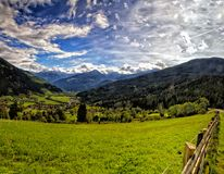 Green meadows and Landscape of Austrian Alps Stock Image