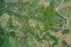 Green meadows, small houses and roads in Transylvania, Romania. Drone view of green meadows, small houses and roads in Transylvania, Romania stock photo