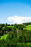 Green Meadows and Trees near Ilam Hall  in Peak District Nationa Stock Photography