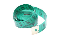 Green measuring tape. On a white background Stock Image
