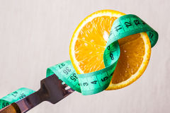 Green measuring tape and orange fruit Stock Photo