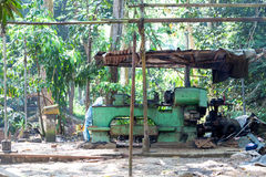 A green mechanical engine lathe is standing in the jungle of Unawattuna Royalty Free Stock Image