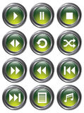 Green Media Buttons. A set of 12 shiny green media buttons with metallic borders Stock Image