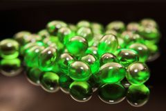 Green medical capsules Royalty Free Stock Photos