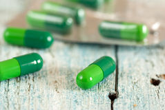 Green medical capsules Stock Image