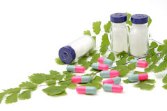 Green medical concept ,medical ampoule and pills Stock Photos