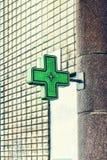 Green medical cross, Pharmacy Neon Sign. Drug store. Pharmacy concept, medicine, symbol,. Green medical cross attached to the pharmacy building. Pharmacy Neon stock image