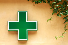 Green medical cross sign Royalty Free Stock Images