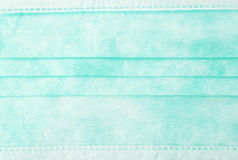 Green medical surgical protective mask texture as abstract background Stock Photo