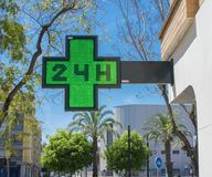 medical twenty-four-hour drugstore signboard at day