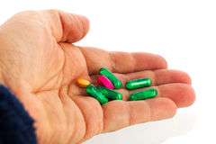 Green medicine in capsules Stock Image