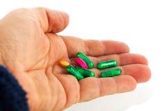 Green medicine in capsules Stock Image