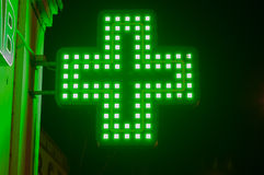 Green medicine cross. Illuminated medicine cross close-up royalty free stock photos