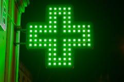 Green medicine cross. Illuminated medicine cross close-up Royalty Free Stock Photos